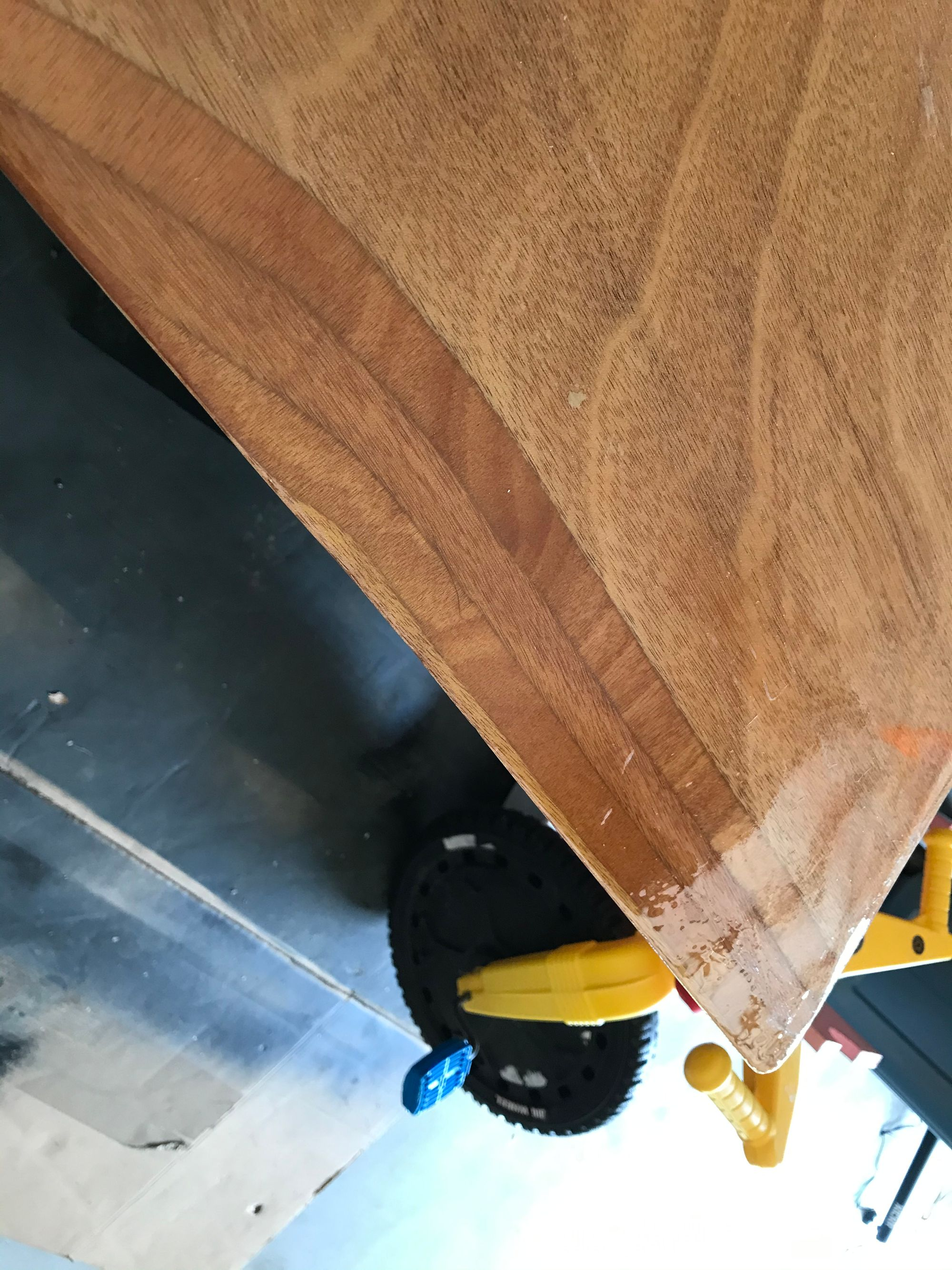Image of a wooden daggerboard, all smooth and shiny