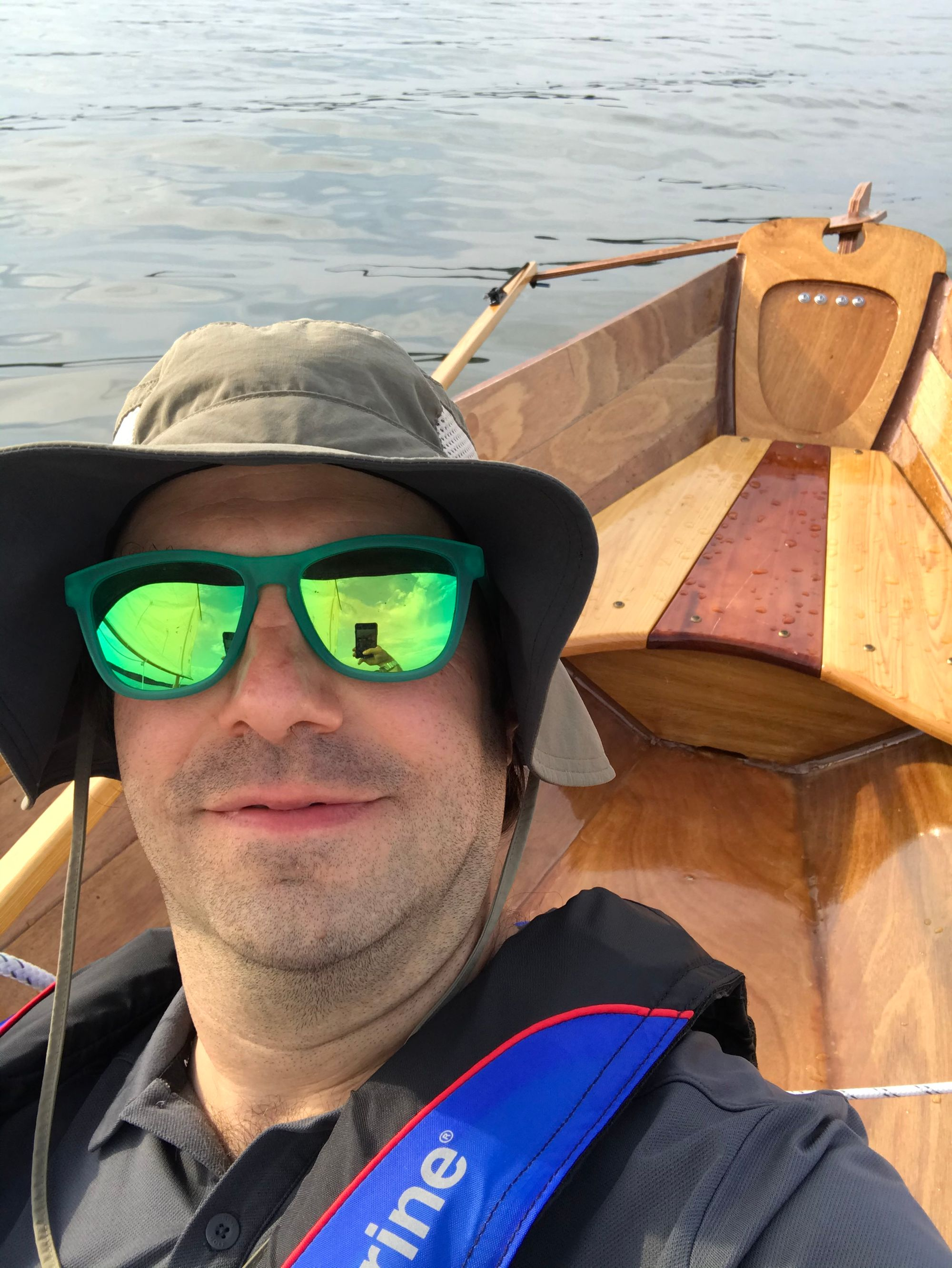 Selfie of the skipper In his new hat and the stern of the boat